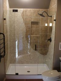 Frameless Shower With River Stone and Tile The way the
