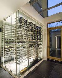 Custom modern glass surround wine cellar designed and ...