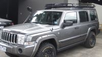 Jeep Commander with Oval Steel roof rack installed on ...