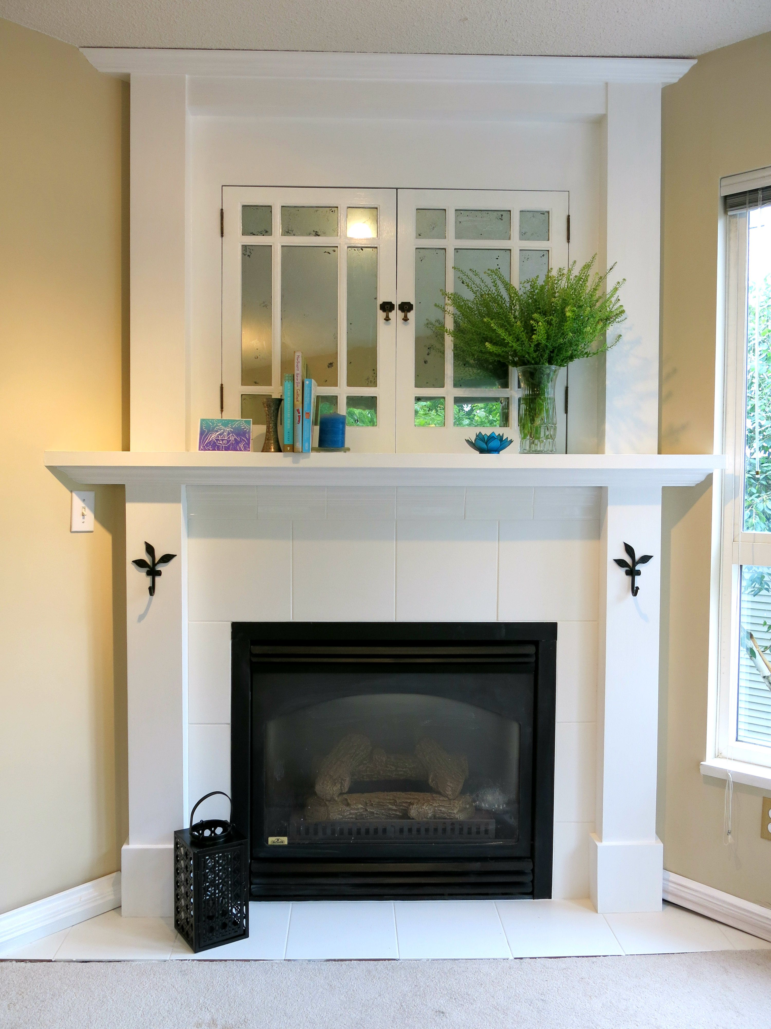 Faux mercury glass old cabinet doors, white tile fireplace