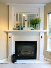 Faux mercury glass old cabinet doors, white tile fireplace ...