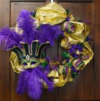 Mardi Gras wreath with mask and feathers. I think I would ...
