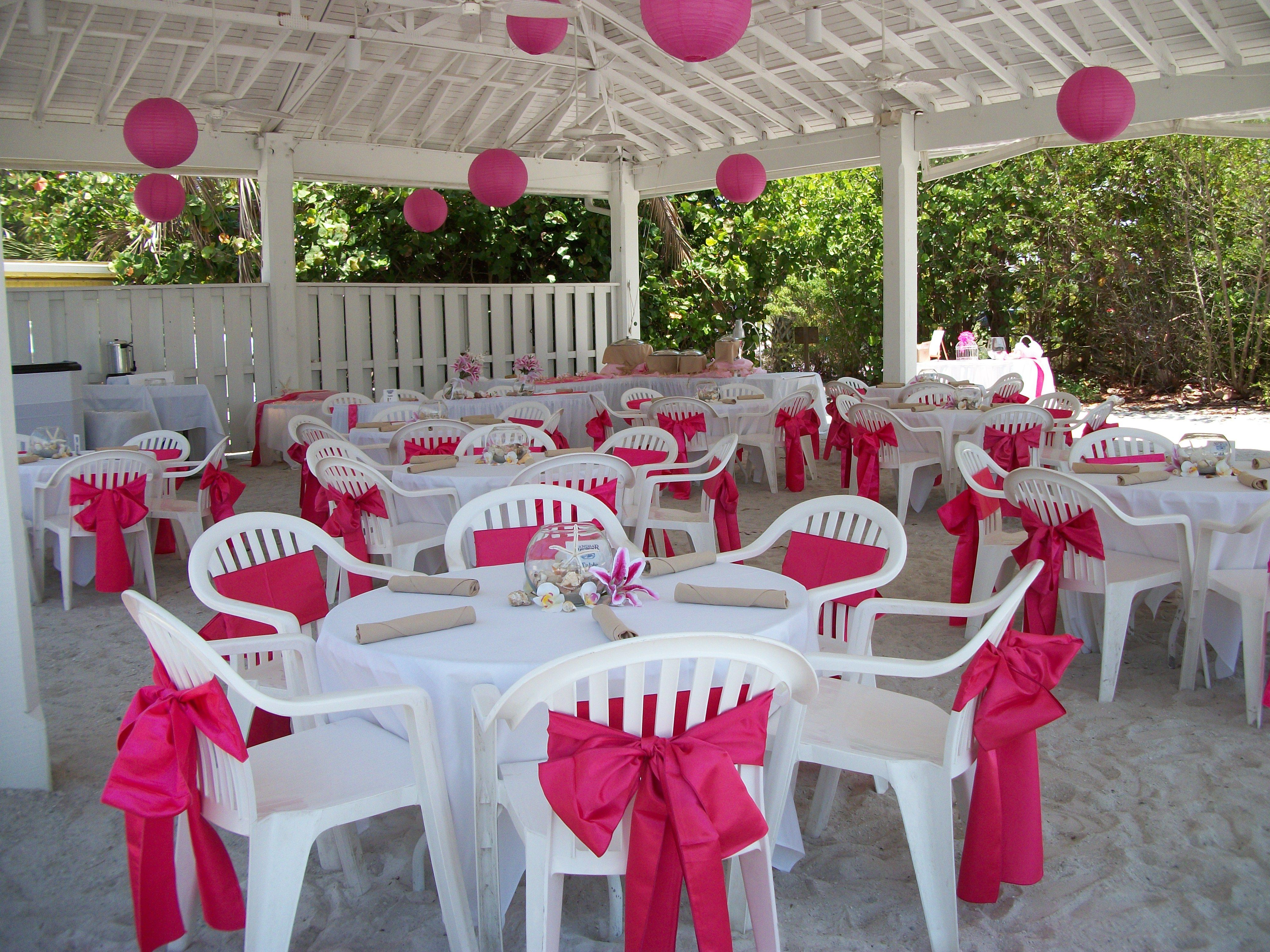chair covers for plastic chairs weddings lazy boy office staples pink wedding under the pavilion at sandbar beach