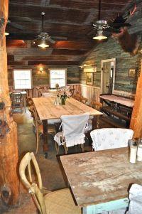 Rustic interior, wood walls, rusty tin ceiling.