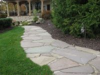 Flagstone walkway with organic edge | Sparks' Landscape ...