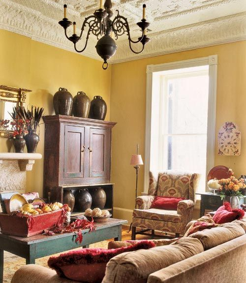 love that teal colored coffee table with the yellow walls  red accents living room design ideas and photos decorating for rooms also you ll ceiling ceilings rh pinterest