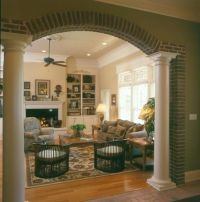 Tuscan living room with white mantle and white built-in ...