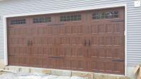 Carriage style garage door. Amarr's Oak Summit, with ...