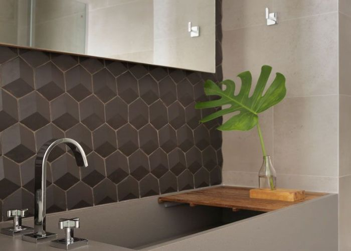 Grey tiles and  vanity with large deep sink set the tone for this also brazilian apartment   interior design features wood accents
