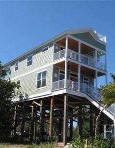 Coastal homes sandcastle custom designed beachfront also rh pinterest