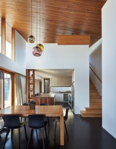 This house extension opens up and becomes double height with  wooden ceiling that also rh pinterest