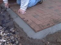 Cement bead for securing edge on brick pavers. Brick ...