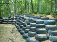 I did this! Retaining wall made from used tires ...