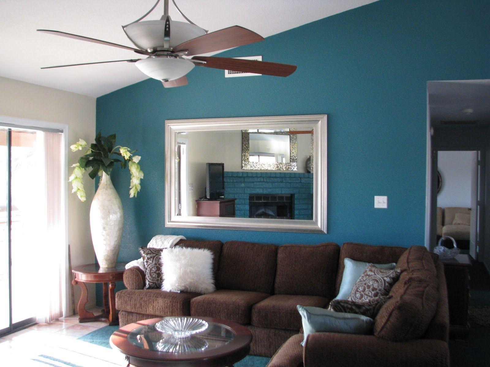 Living room with wood floor teal wall - Deep Teal Wall Color Modern Living Room Decor Ideas Brown Sofa Wood Floor Interior Design Ideas