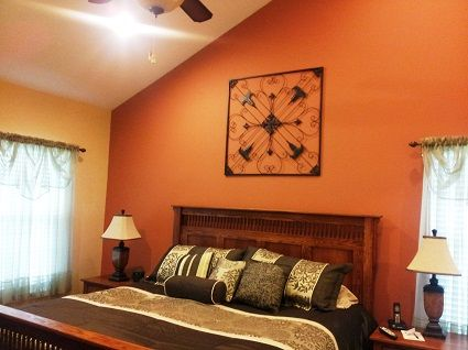 sunset orange for accent wall bedroom Burnt orange accent wall, looks nice against yellow (as