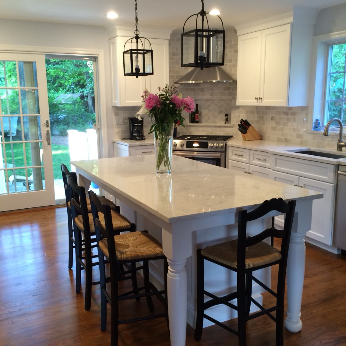 Open concept kitchen and dining room White cabinets and
