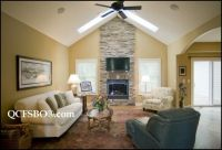 stone fireplace with cathedral ceiling