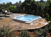 Backyard Jacuzzi spa set in flagstone. http://www ...