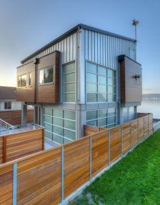 Designs northwest architect designed this modern two story next to the water on camona island in washington also tsunami house coastal living rh pinterest