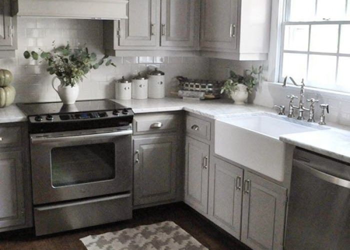 White glass subway tile also painted kitchen cabinets marble