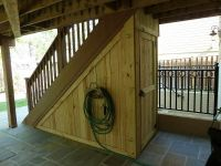 This wood storage shed takes advantage of the space ...