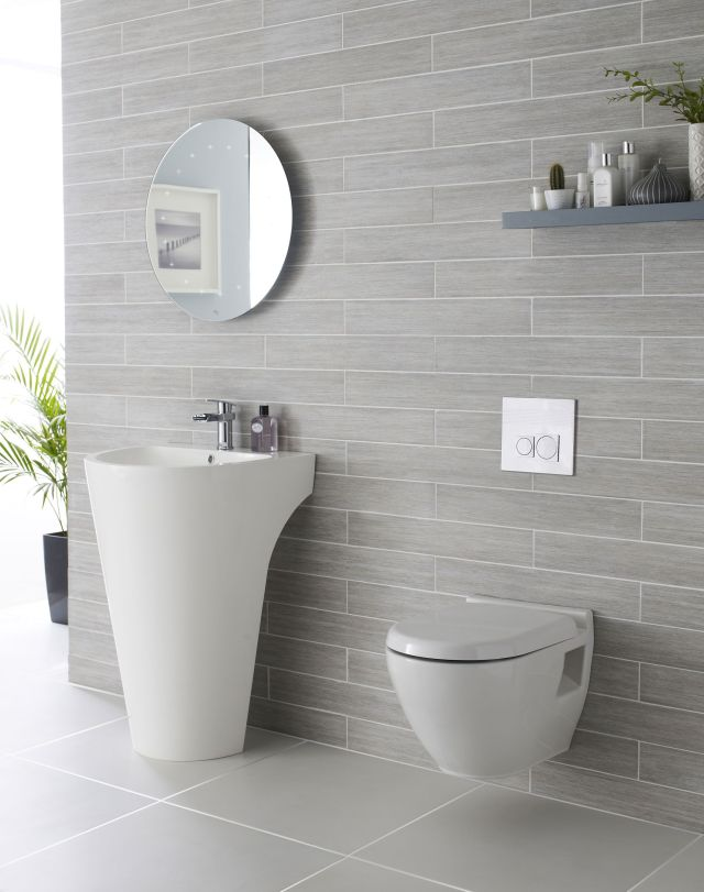 We adore this white and grey bathroom plete with Lavish basin