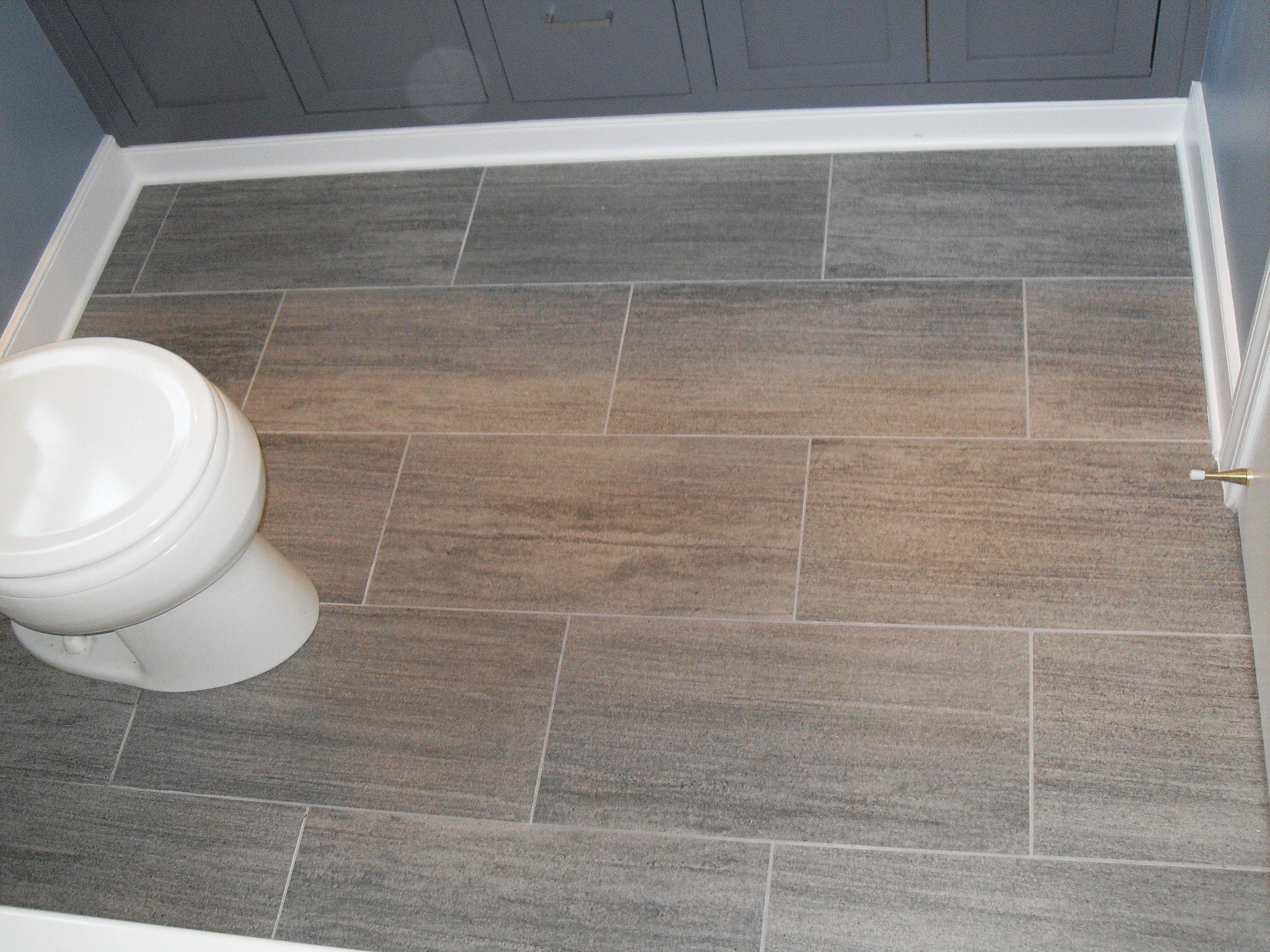 The bathroom floor tile ideas with grey porcelain floor