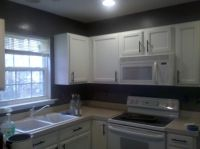 dark gray kitchen walls with white cabinets