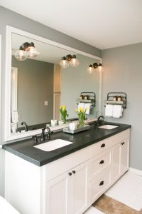 The master bathroom has black granite countertops with