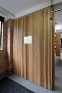 Floor-to-ceiling oak veneer room dividers with partition ...