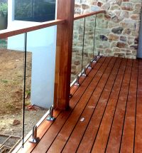 Glass Balustrades attached to timber decking with ...