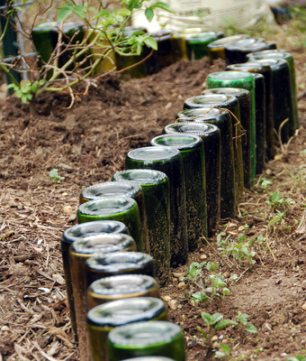 Use Old Wine Bottles To Create A Garden Bed Border Or Make A Raised Bed