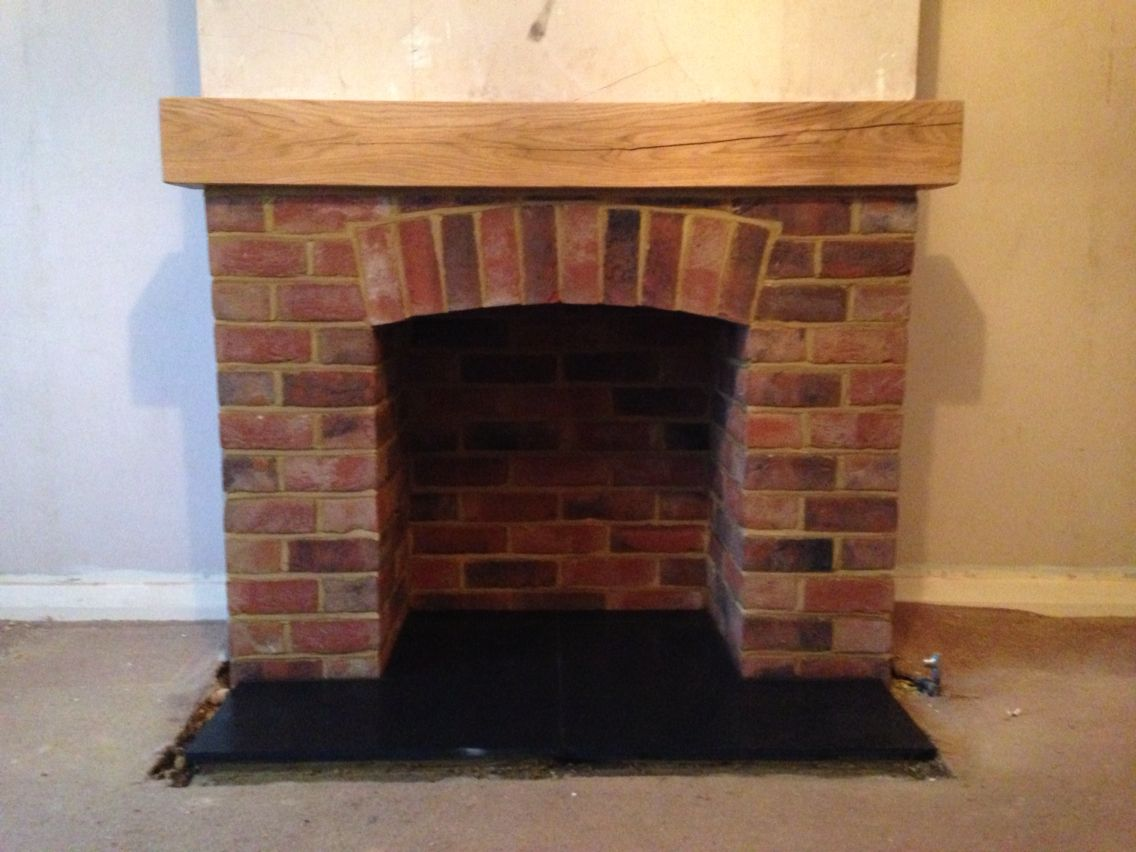 Brick fireplace with oak mantel