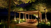 Outdoor dining area at night - Marcus Barnett Landscape ...