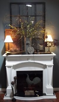 Fireplace Decor - I really like the greenery on the mantle ...