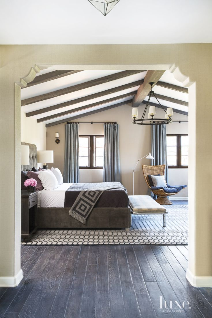 spanish colonial neutral bedroom with vintage bench | master