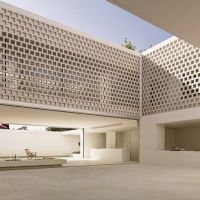 Perforated walls bring light into the heart of Gus ...