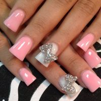 Light pink glitter acrylic nails...to long for me but I do ...