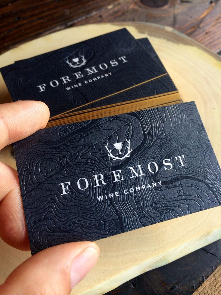 black business cards with gold writing