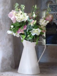 Vintage jugs of flowers including stocks, lisianthus ...