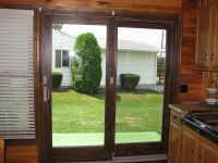 The Andersen Perma-Shield sliding patio door has a rigid ...