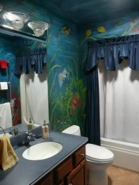 Shark and fish on a bathroom wall. Underwater mural ...