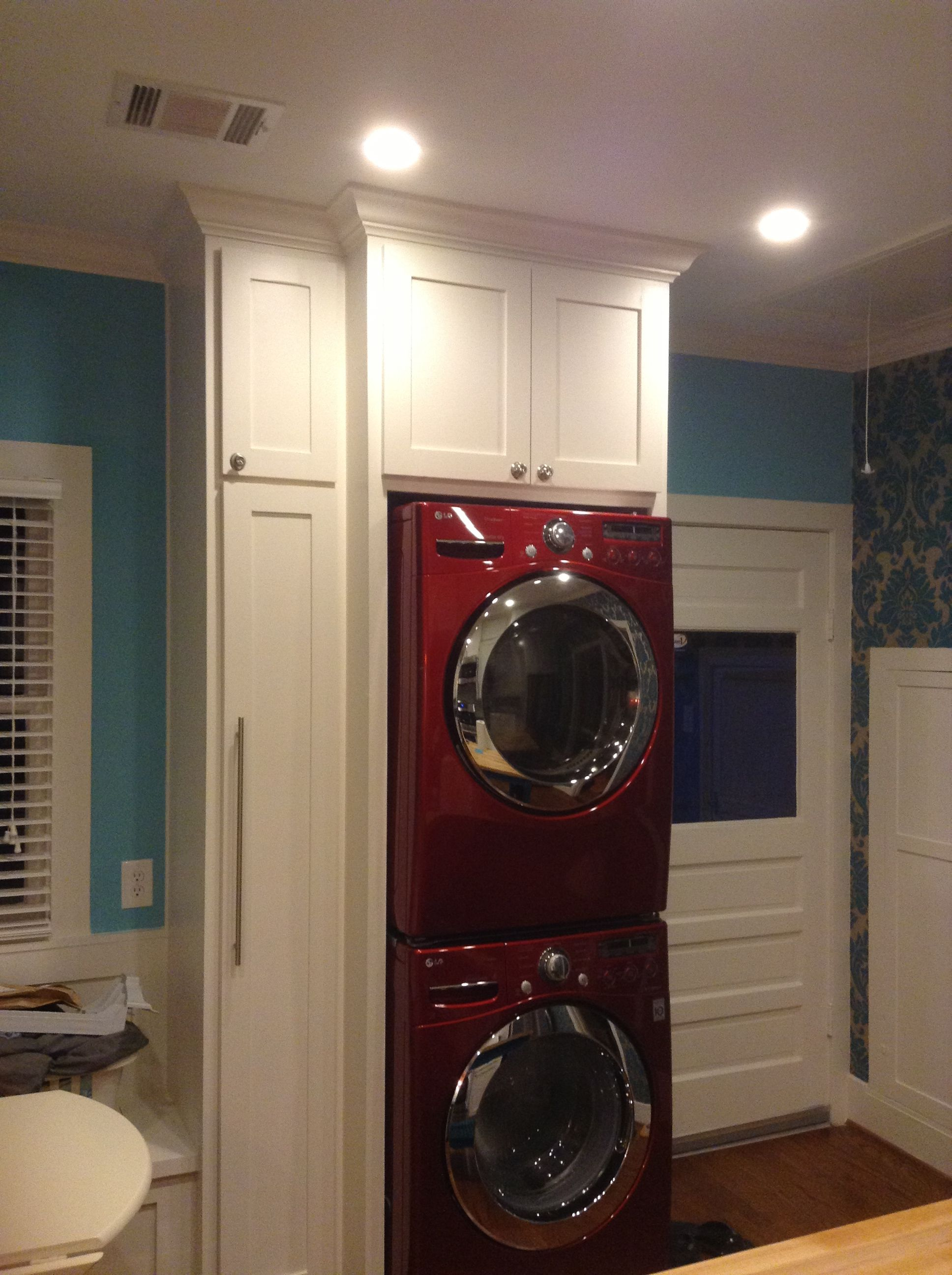 Red Lg Stacked Washer Dryer Laundry Area In Kitchen