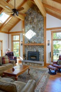 Family room with vaulted ceiling and stone fireplace. The ...
