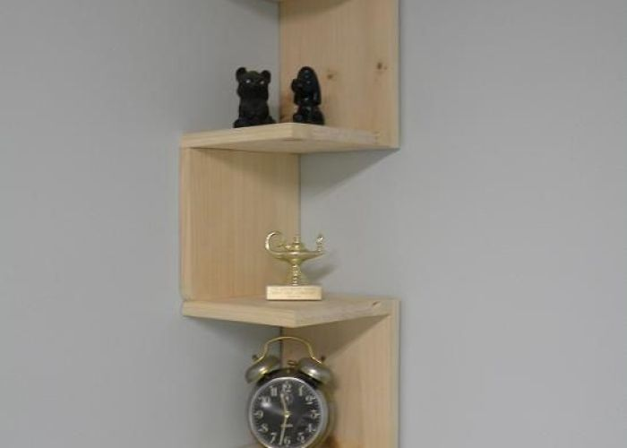 Wall mounted corner shelf  like the design and how it attracts eye but picture this made with reclaimed pallet wood doubling or even tripling up also easy to make woody pinterest shelves