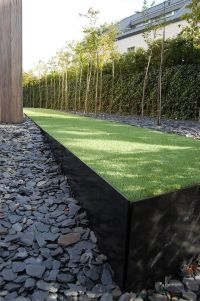 Raised lawn planter with contemporary minimalist edging ...
