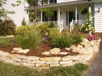 In this photo, the stacked stone is edging the flowerbed ...