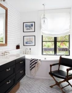 Bathroom with herringbone floor tile white subway wall free standing tub black top interior designerswhite also rh nz pinterest