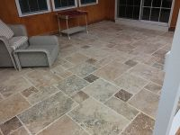 Screen porch floor with Travertine tile by Archadeck of