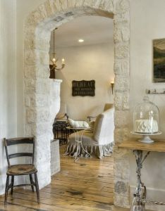 The wood floors and stone archway also love this rustic look for rh pinterest
